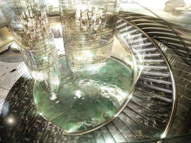 The centerpiece of the salon is a huge chandelier surrounded by a circular staircase.