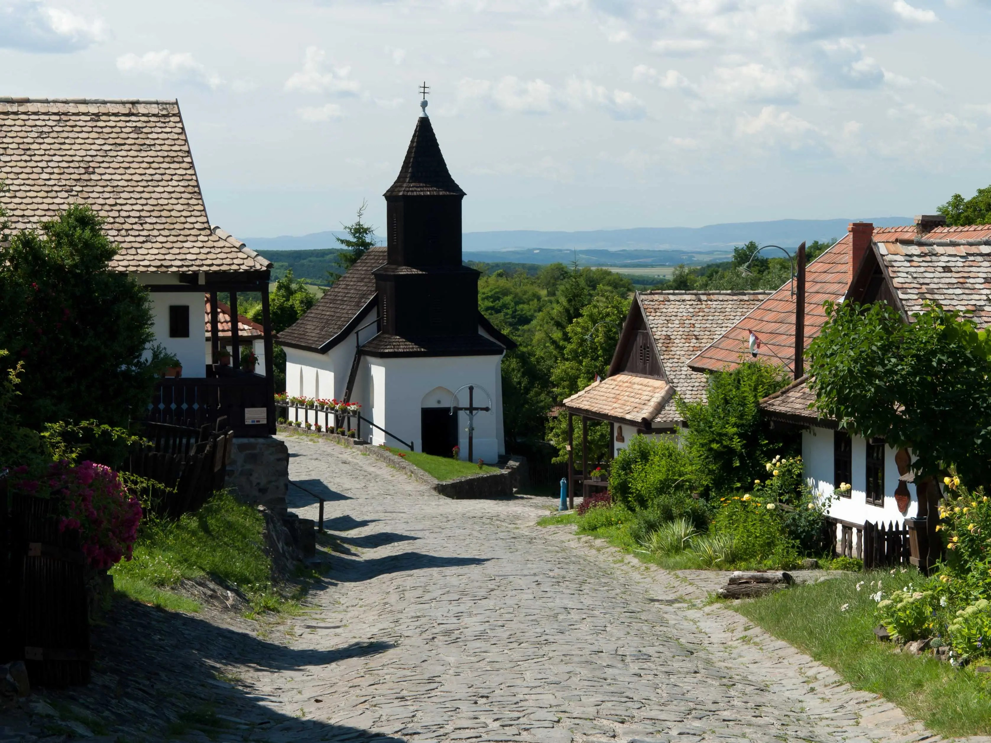 """UNESCO describes Hollokö, located in Nógrád in northern Hungary, as a """"living example of rural life before the agricultural revolution of the 20th century,"""" thanks to its wide array of orchards, vineyards, meadows, woods, and medieval castle ruins dating back to 1310."""