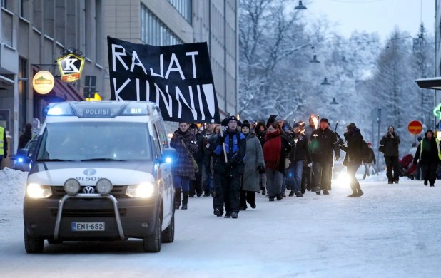 Anti-immigration marchers are led by a police van on the streets in Tampere, Finland January 23, 2016.