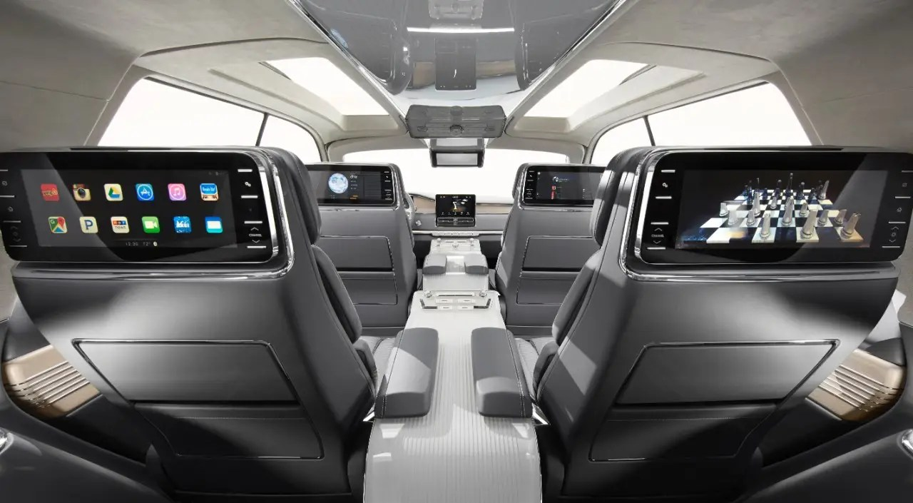 The six seats inside can be adjusted 30 different ways, and there's entertainment consoles on the back of four seats so passengers can watch TV or play games.