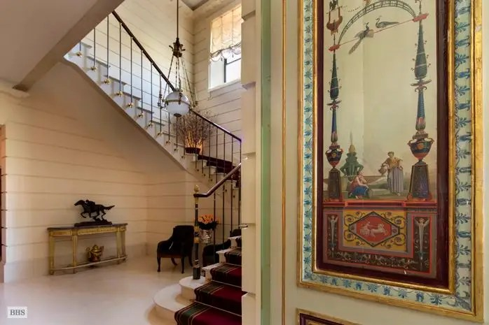 A grand marble staircase takes you between floors.