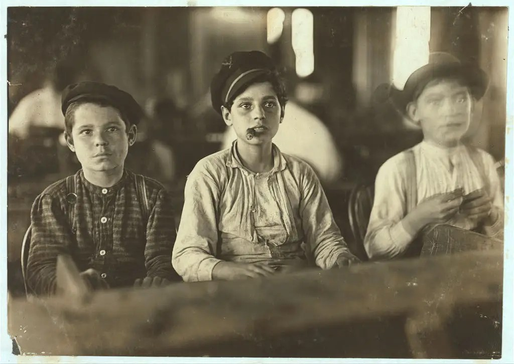 Young cigarmakers at Englahardt & Co., Tampa, Florida. These boys looked under 14. Work was slack and youngsters were not being employed much. Youngsters all smoke. Witness Sara R. Hine. Taken January 1909.