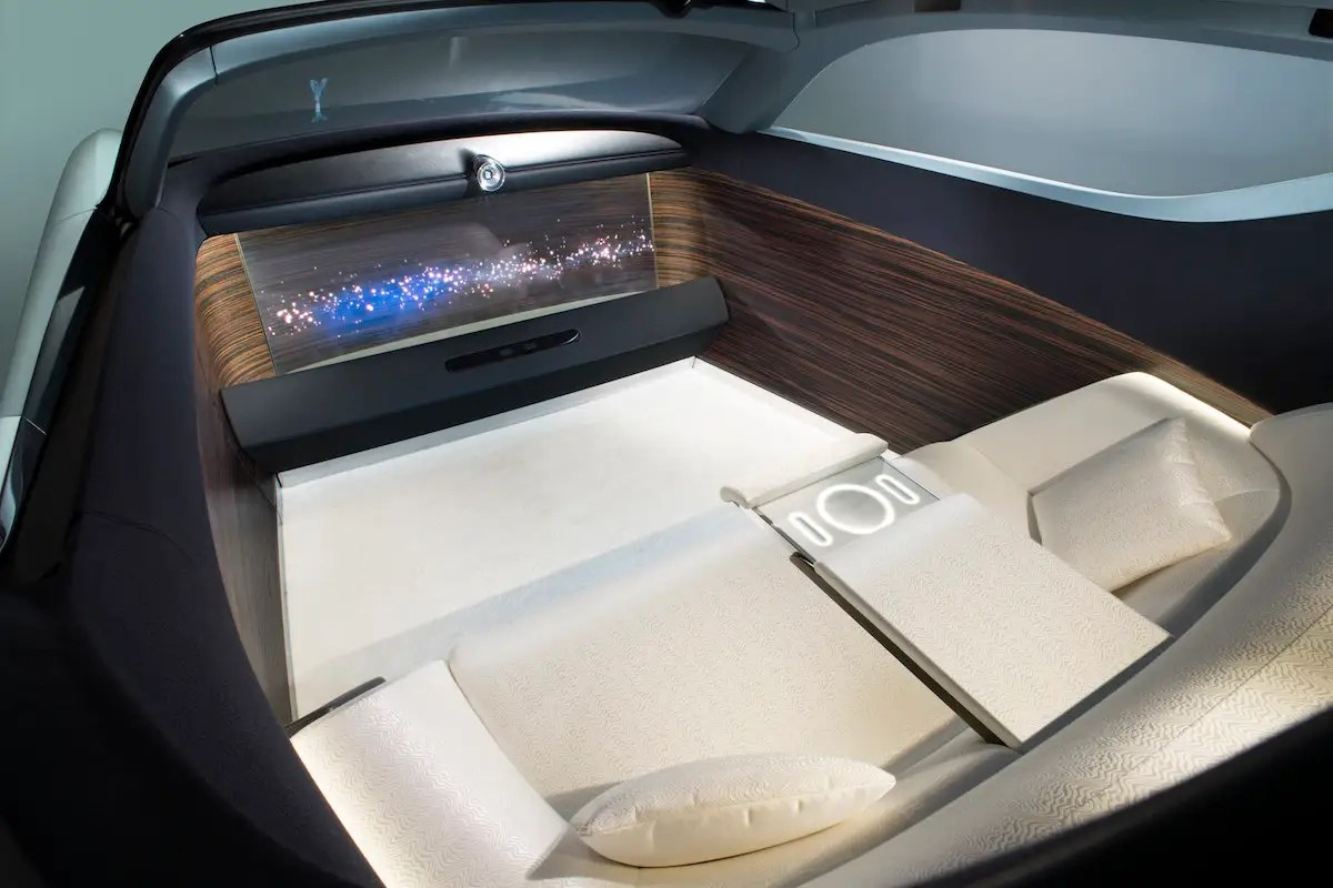 Because the car envisions a completely autonomous future, the interior is composed entirely of a two-person, silk sofa and a giant OLED TV.