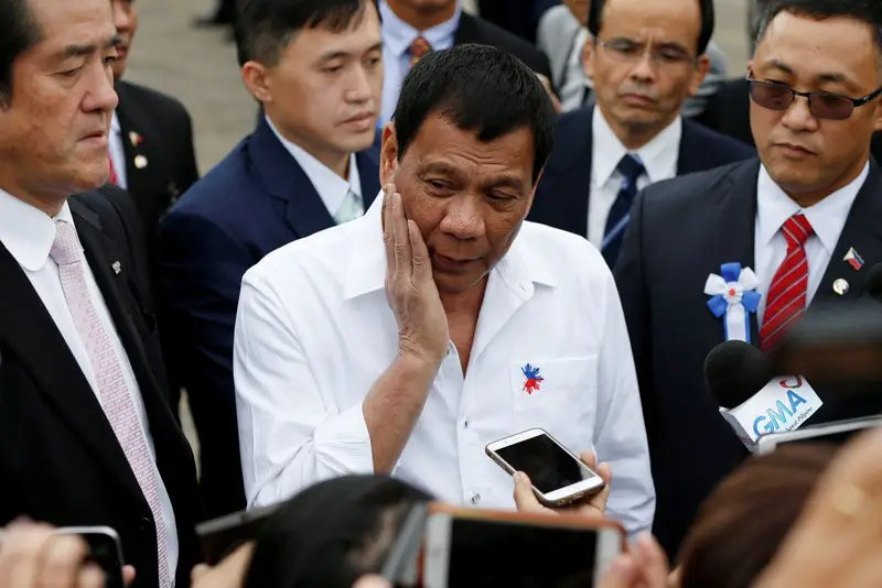 Philippine President Rodrigo Duterte (C) speaks to the media after his inspection at Japan Coast Guard base in Yokohama, south of Tokyo, Japan October 27, 2016. REUTERS/Issei Kato