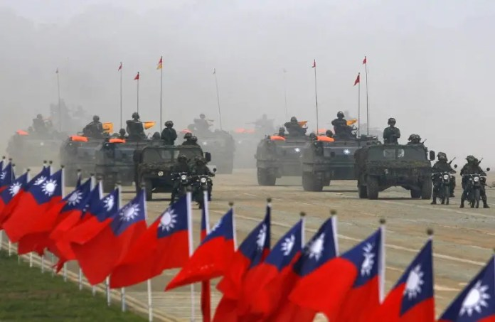 Soldiers drive their military vehicles past Taiwan flags during an army exercise in Hsinchu, central Taiwan January 27, 2010.  REUTERS/Nicky Loh  China's Xi swears to 'defeat separatist attempts' from Taiwan China's Xi swears to 'defeat separatist attempts' from Taiwan china upset about negative taiwan content in us defense bill