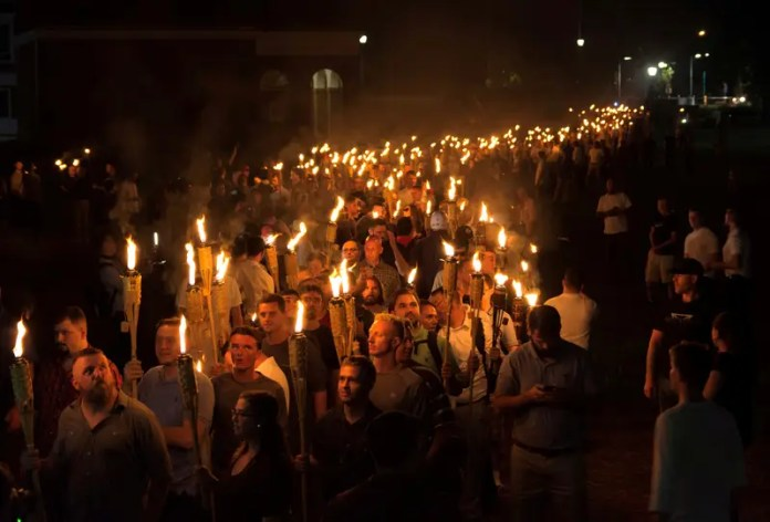 White nationalists carry torches on the grounds of the University of Virginia, on the eve of a planned Unite The Right rally in Charlottesville, Virginia, U.S. August 11, 2017. Alvarez/News2Share via REUTERS The US is seeing an uptick in far-right extremist violence The US is seeing an uptick in far-right extremist violence in charlottesville germans see echoes of their struggle with history