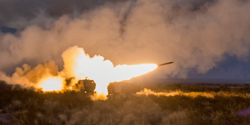 Six High Mobility Artillery Rocket Systems (HIMARS) of Alpha Battery, 1st Battalion, 121st Field Artillery conduct a battery fire during a July 21 live fire exercise as part of pre-deployment training at Ft. Bliss, Texas.