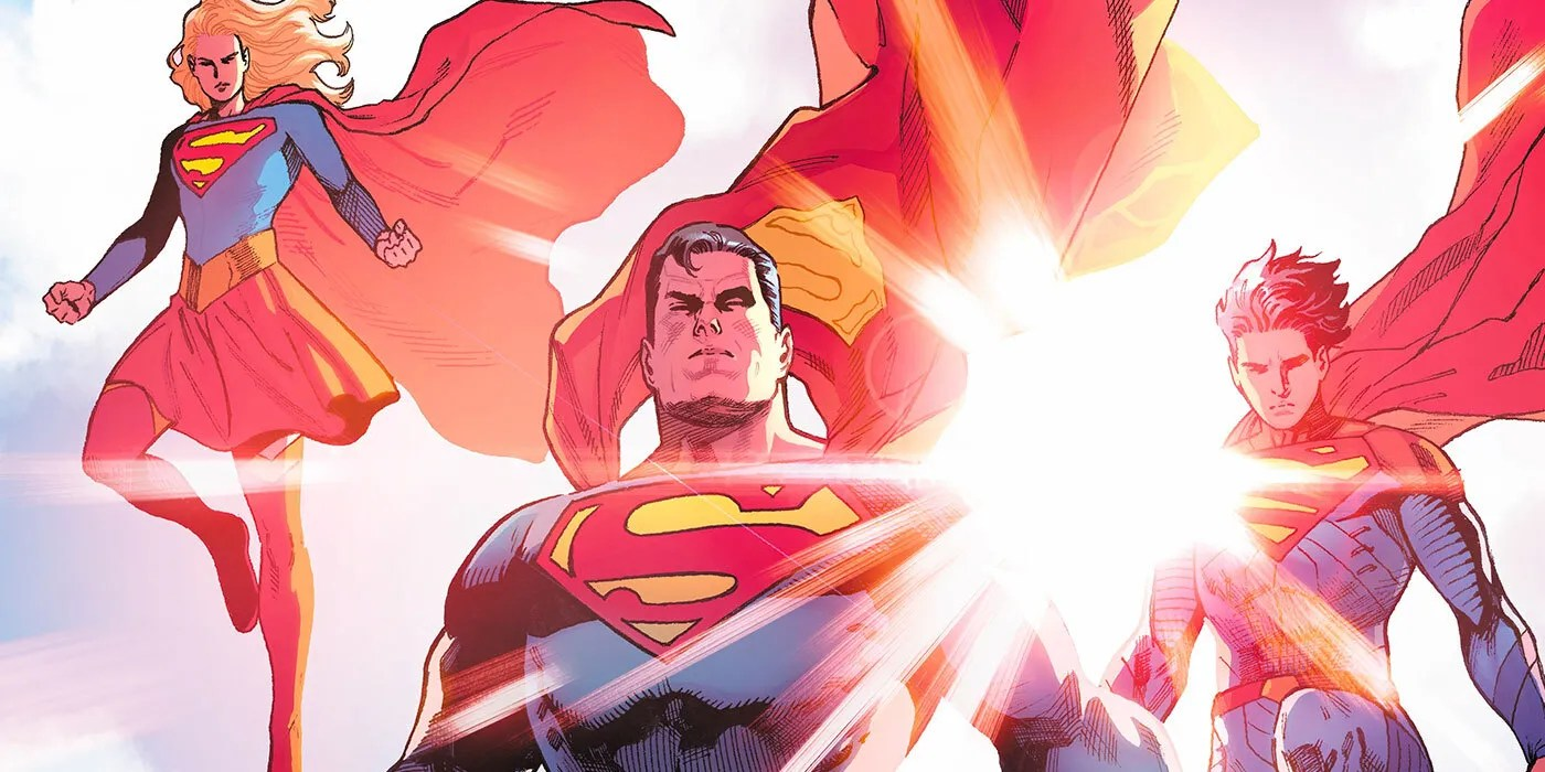 Supergirl, Superman, and Jonathan Kent descend with the sun at their backs.