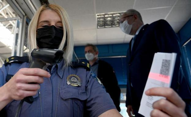An agent scans one of the issued certificates.