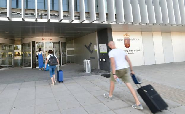 Travelers entering the regional airport in a file image.