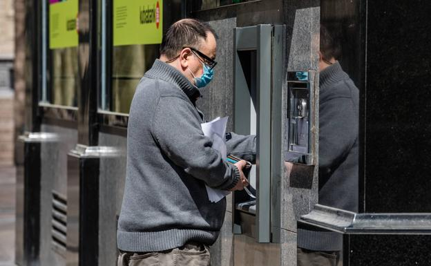 A man taking money from the ATM.