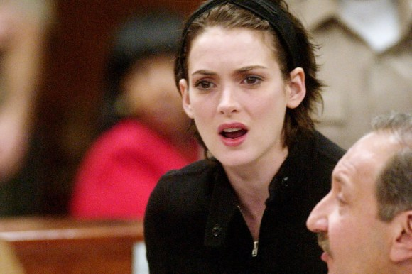Actress Winona Ryder reacts in court during her sentencing hearing of her shoplifting case in Beverly Hills, Calif., Friday, Dec. 6, 2002. At right is Ryder's lawyer Mark Geragos. Ryder was sentenced to probation, community service and fines. (AP Photo/Steve Grayson,pool)