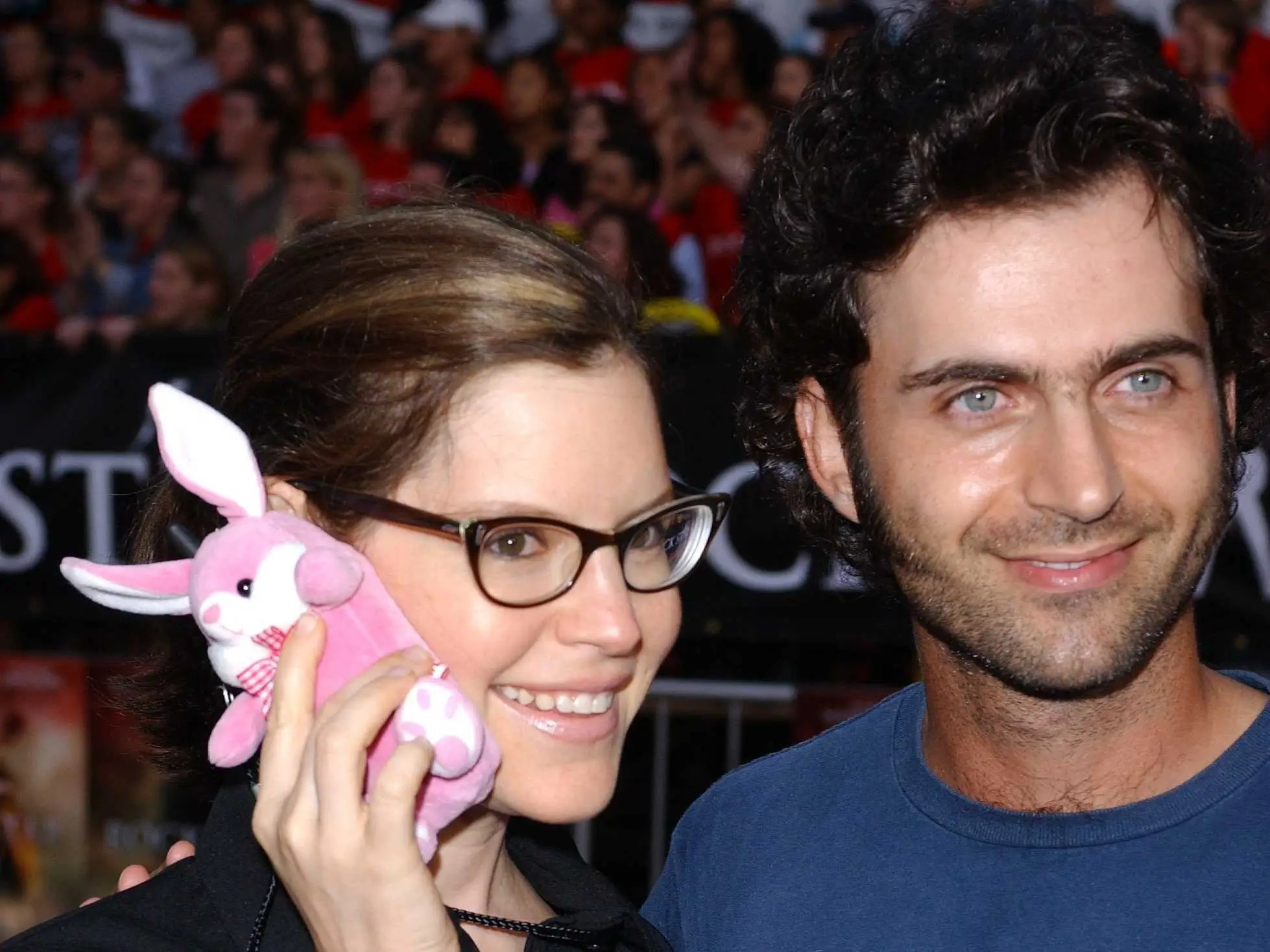 September 2001: Lisa Loeb, alongside Dweezil Zappa, shows off her bunny cell phone case in Westwood, CA.
