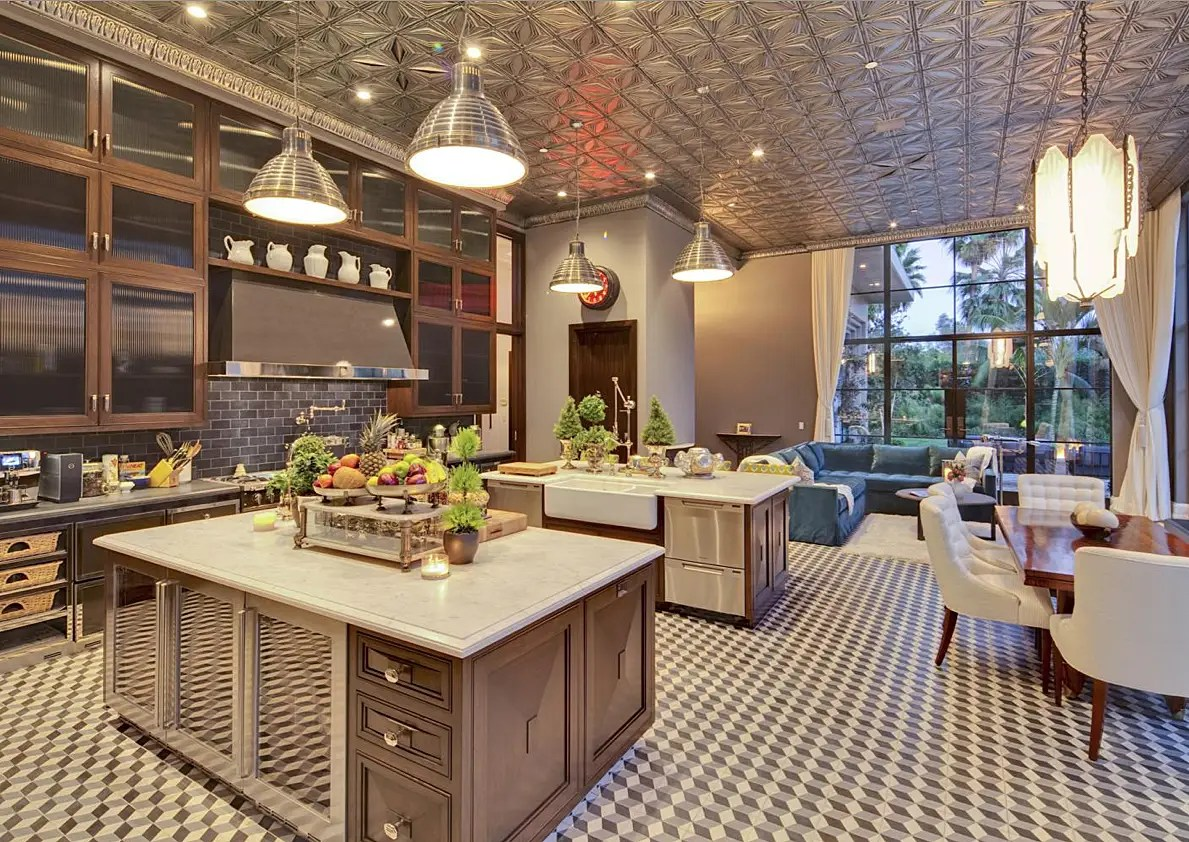 The kitchen has a unique tin ceiling, two islands, and a breakfast nook.