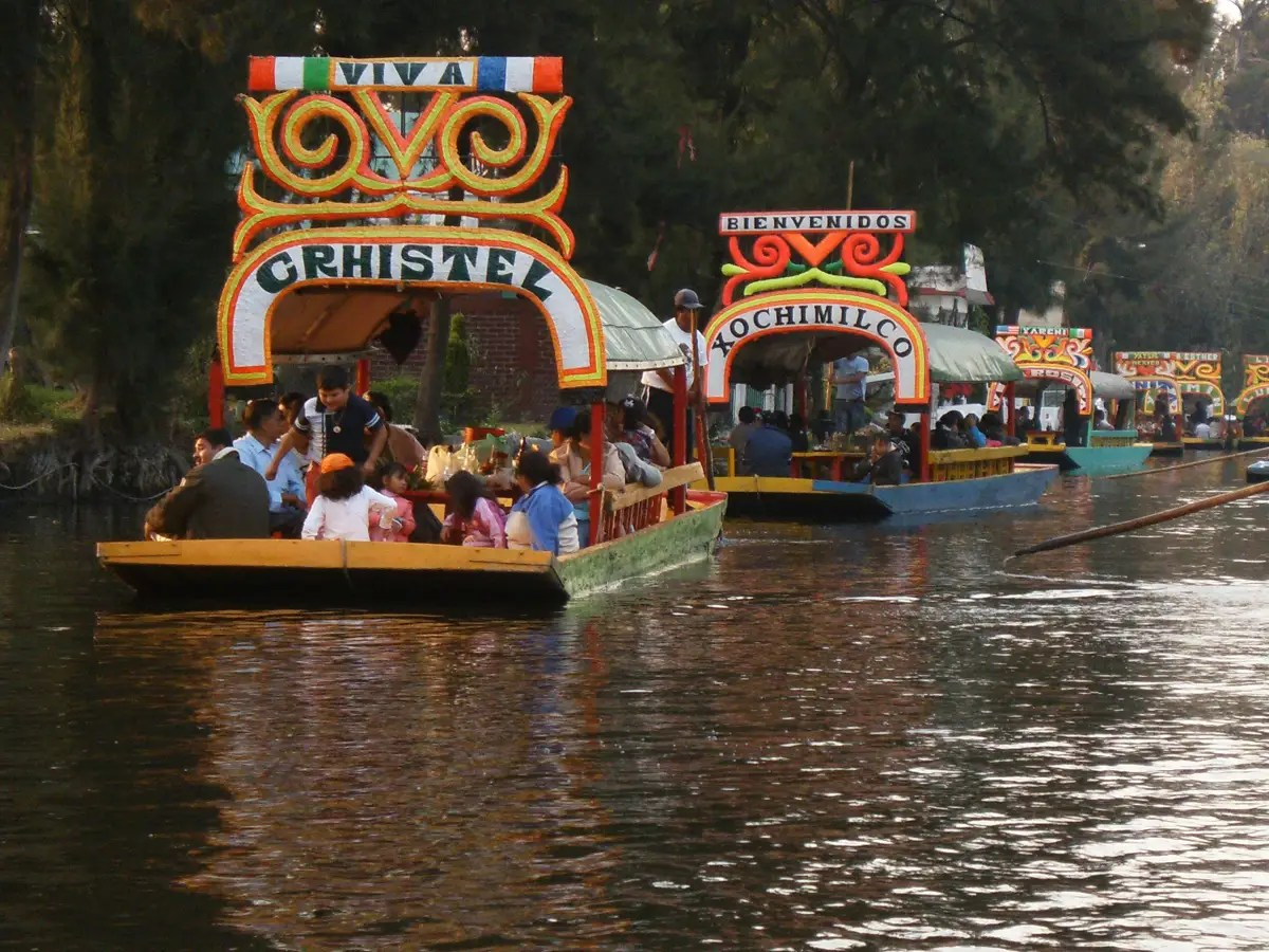 Ride the canals of Xochimilco, outside of Mexico City in a trajinera (a brightly-painted non-motorized barge).
