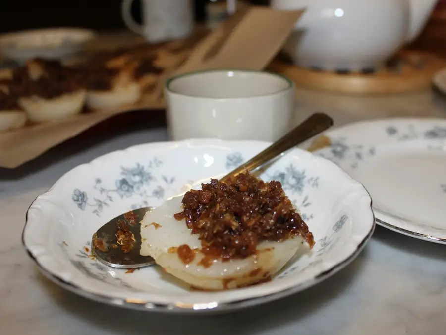 Chui Kueh is a dense rice cake that's topped with savory preserved vegetables.
