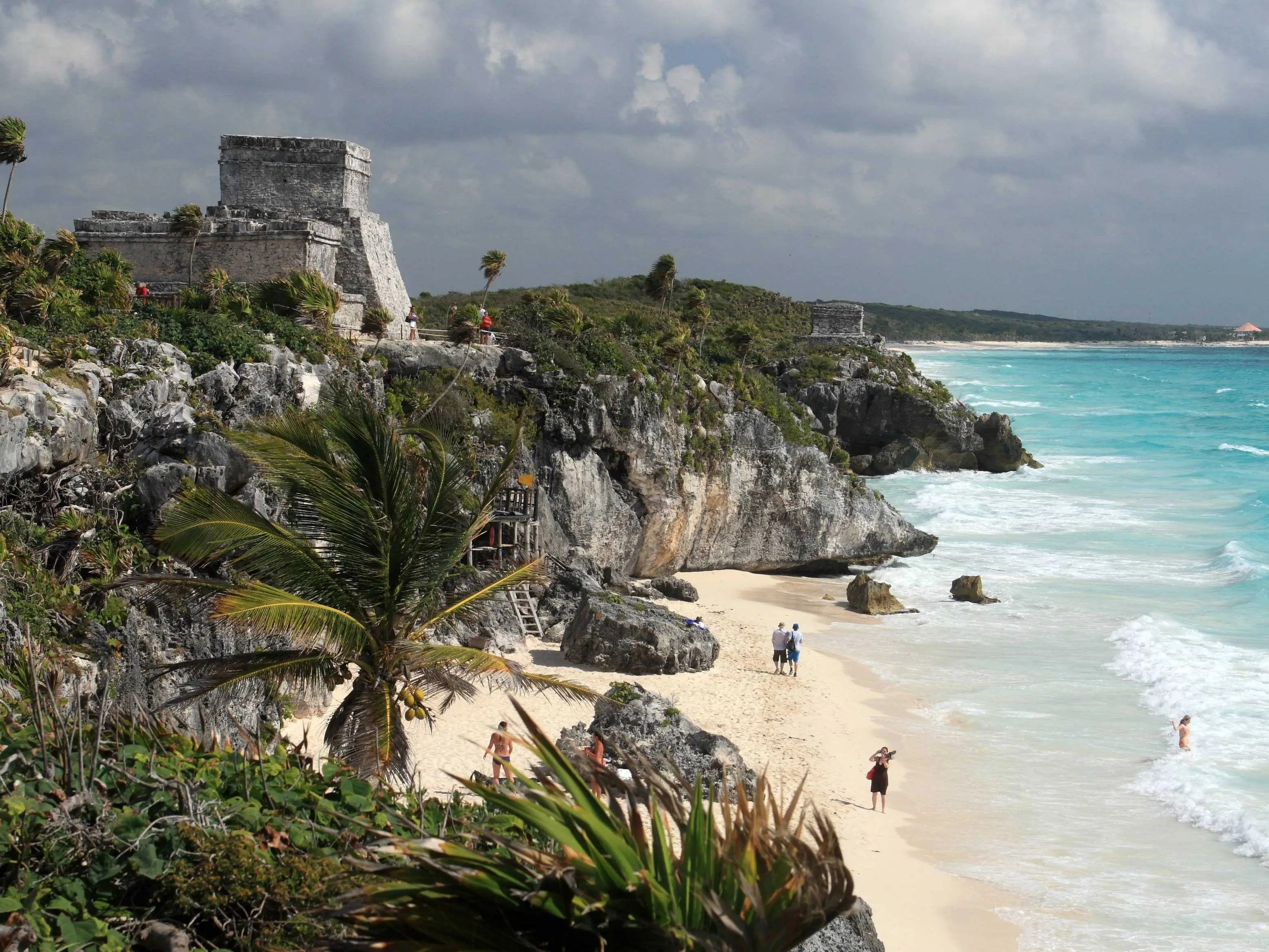 Mayan ships used to dock at Mexico's Tulum beach while on trade routes around the Yucatán peninsula. Now, beachgoers can swim and relax beneath the ancient Mayan ruins that overlook the Caribbean Sea.