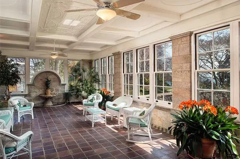 The huge solarium has a coffered ceiling plus tons of light and views of the water.