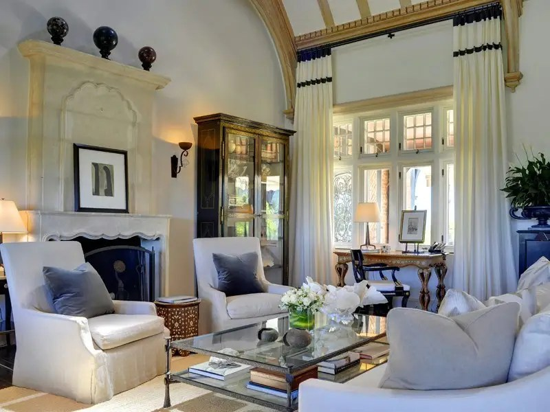 There are plenty of snug living room areas that look out on the vast lawn.