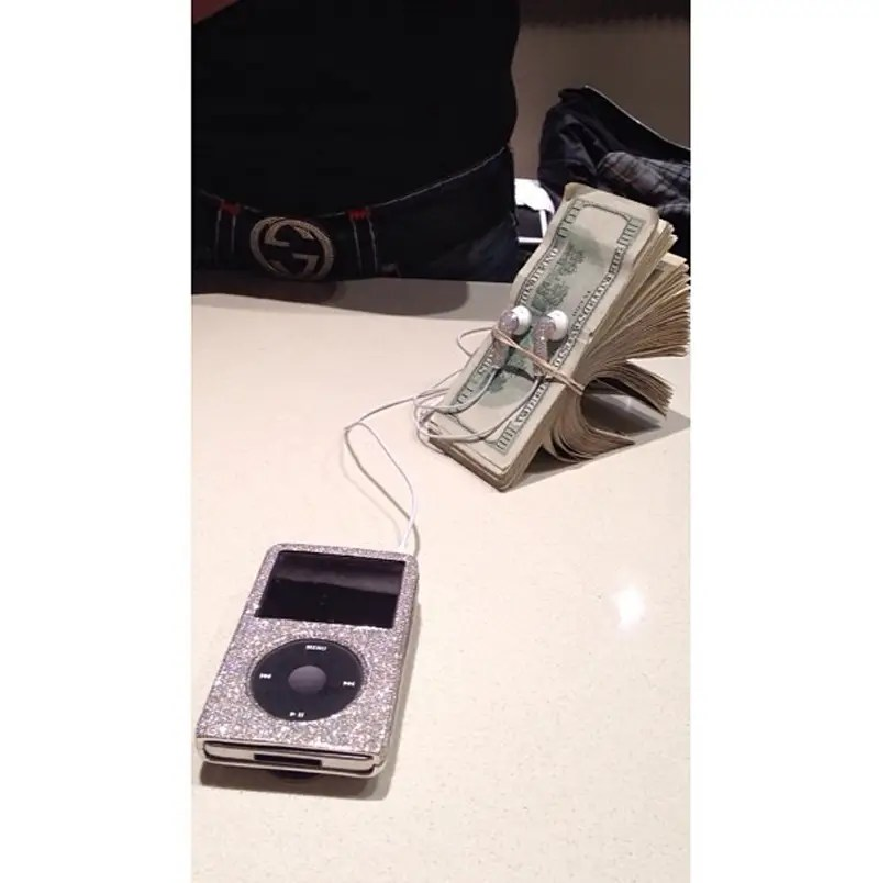 "He wrapped his iPod earphones around a stack of money and posted it with the caption, ""Money is music to my ears."""