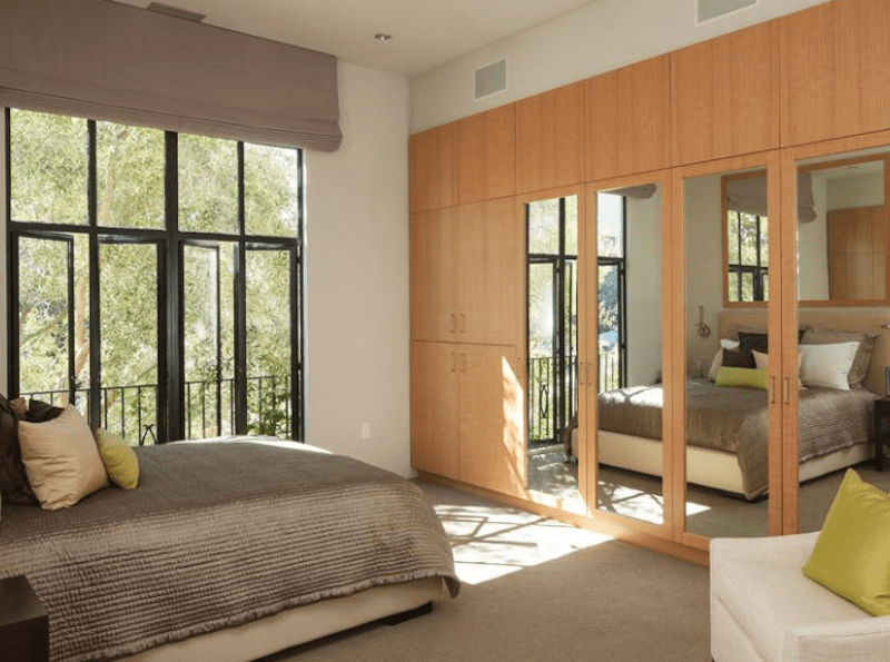Two separate bedrooms in the master suite have built-in desks and plenty of mirrored closet space.