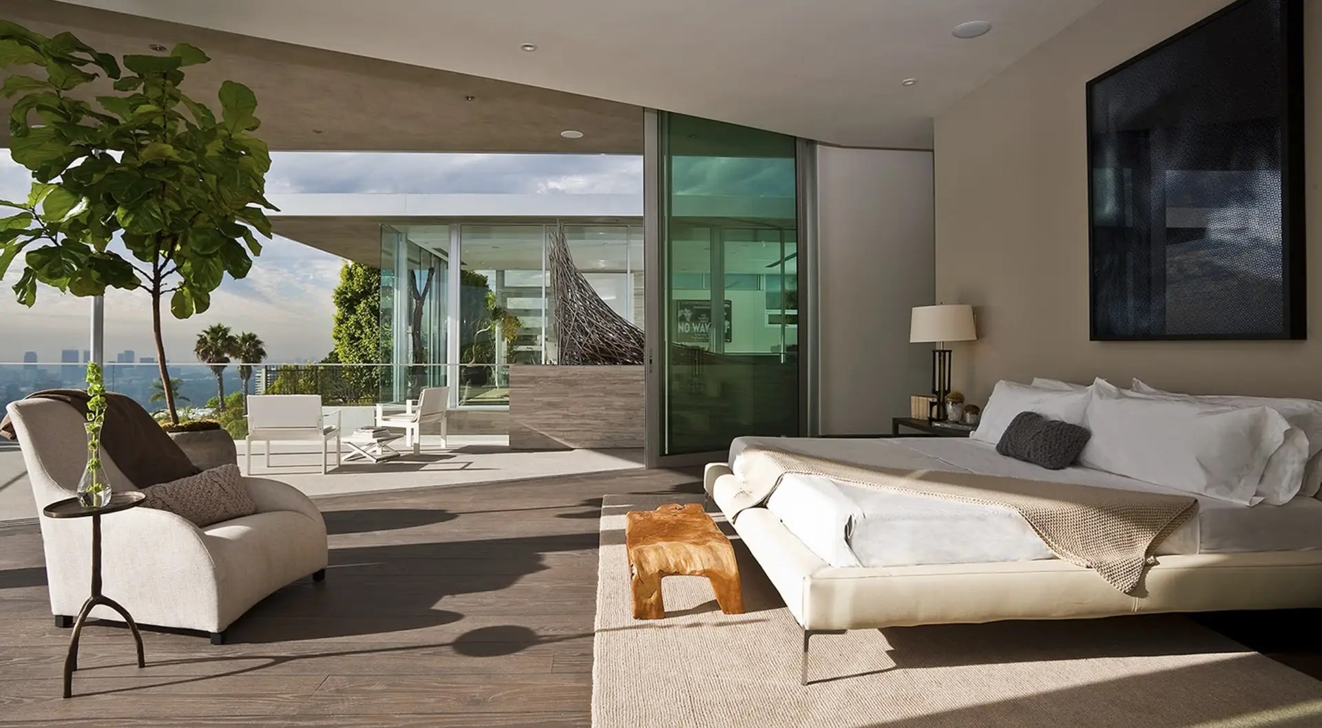 The bedrooms' glass walls pull back for an open-air sleeping experience.