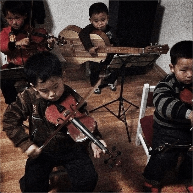 'A group of children practicing with their instruments in Pyongyang.'