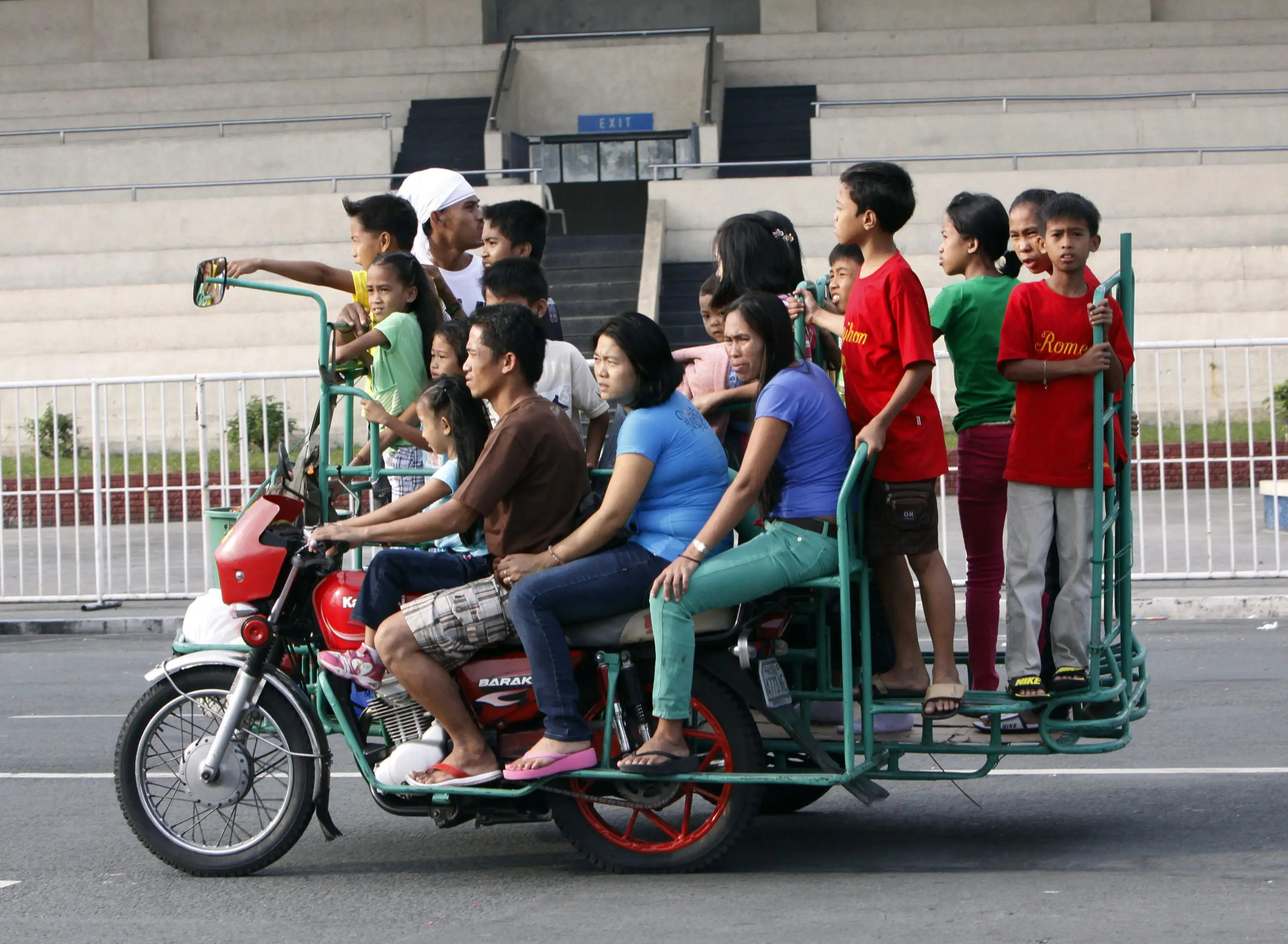 These folks in the Philippines don't need a school bus; they've got a tricycle.