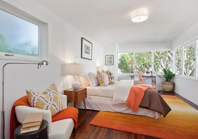 The second bedroom has nice, big windows.