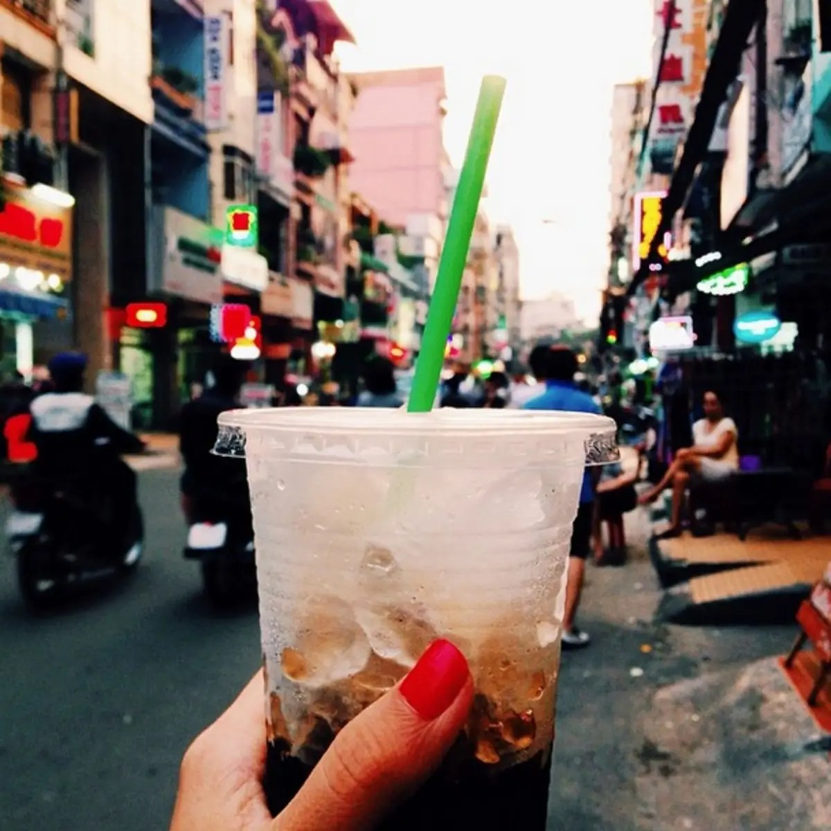 Vietnamese Coffee in Ho Chi Minh, where the motorcycles will avoid you if you just cross the street confidently.