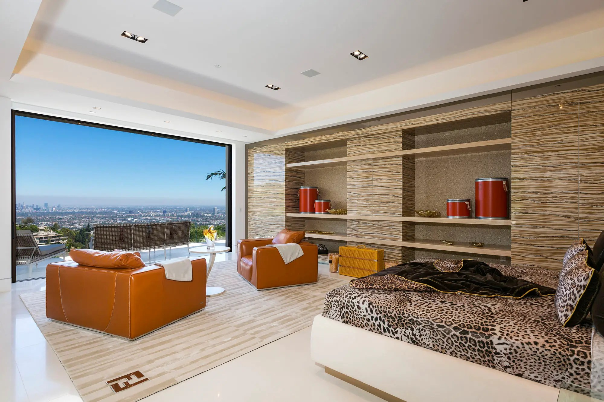 The master bedroom has ample space and a huge floor-to-ceiling window.
