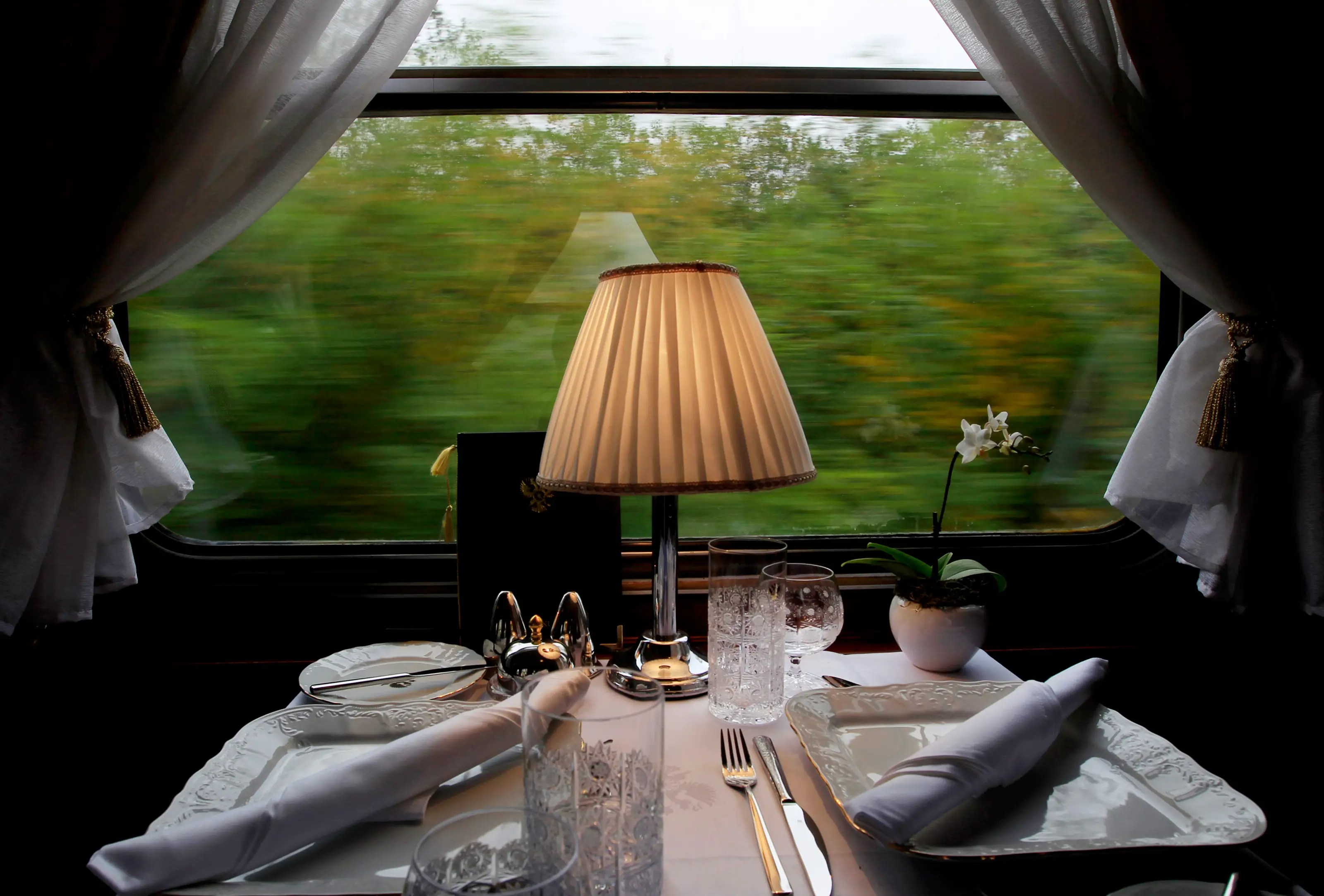 The dining car is furnished with intimate two-seats tables. Outstanding scenery from the windows is a plus.
