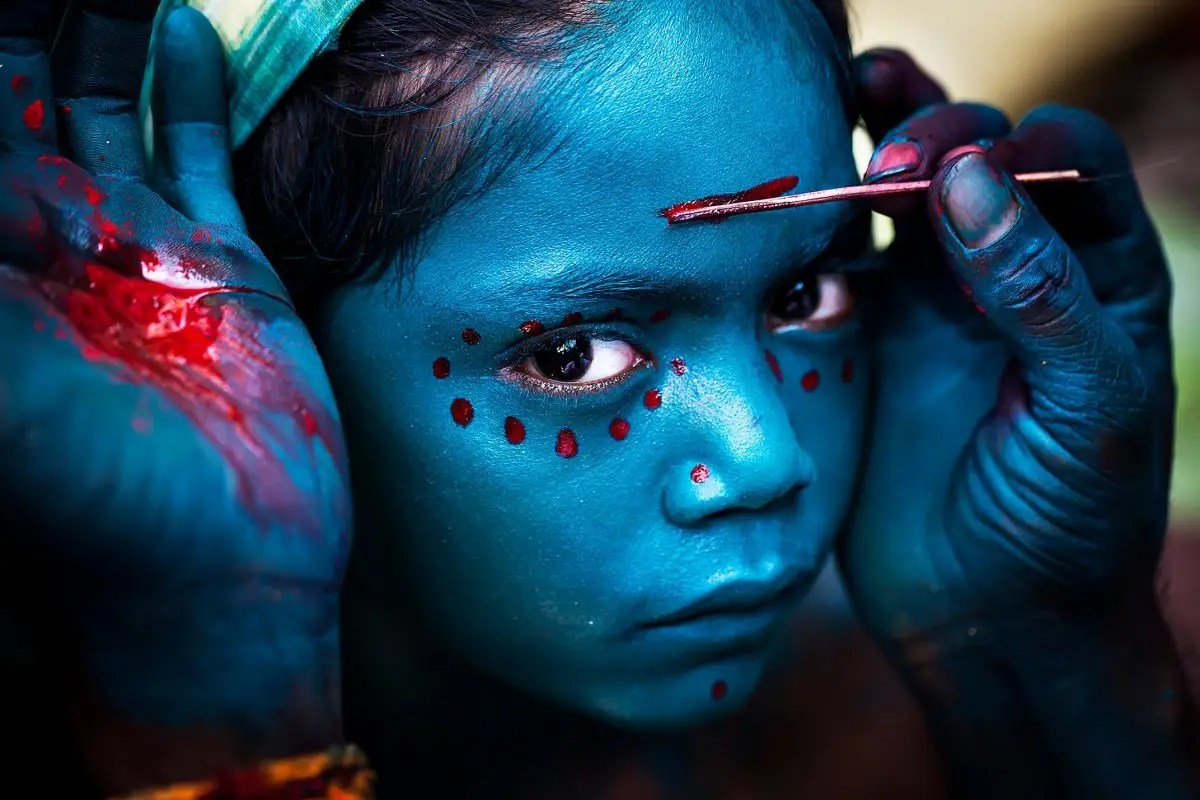 This photo was taken in a small Southern Indian village during the Mayana Soora Thiruvizha festival. The festival is devoted to Angalamman, a guardian deity worshiped in Southern India. It was the merit prize winner of the National Geographic Travelers photo contest.
