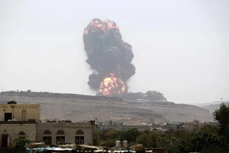 Smoke billows following an air strike by the Saudi-led coalition on an army arms depot, now under Shiite Huthi rebel control, east of Sanaa on May 22, 2015
