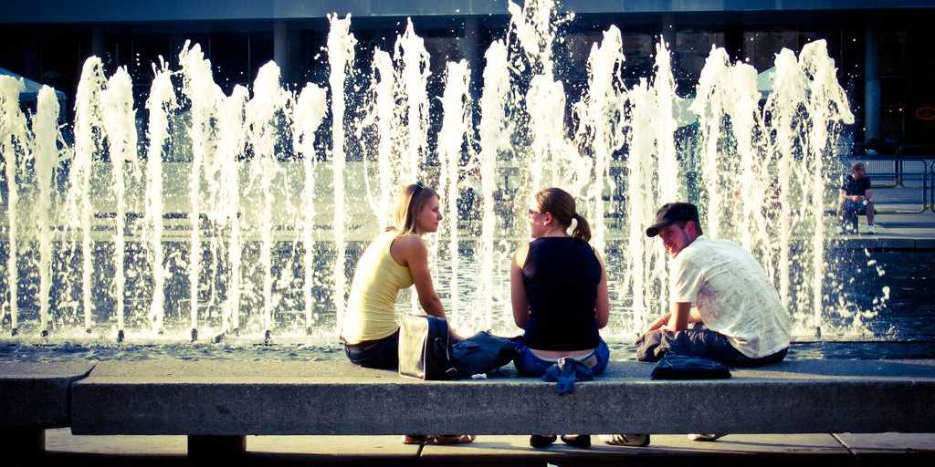 Friends Talking in Front of Fountain