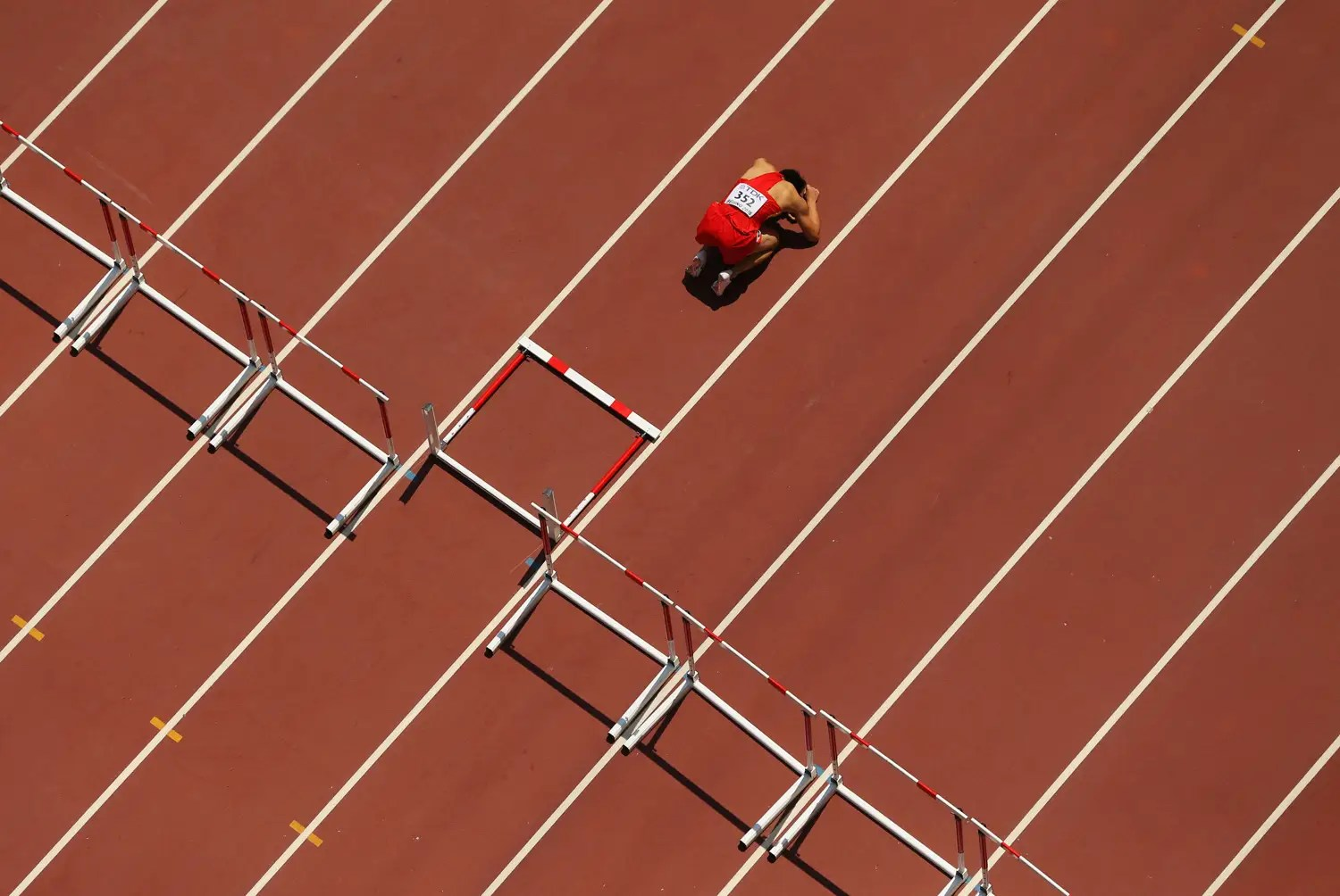 Chinese hurdler Honglin Zhang is devastated after tripping on a hurdle in the 110meters.