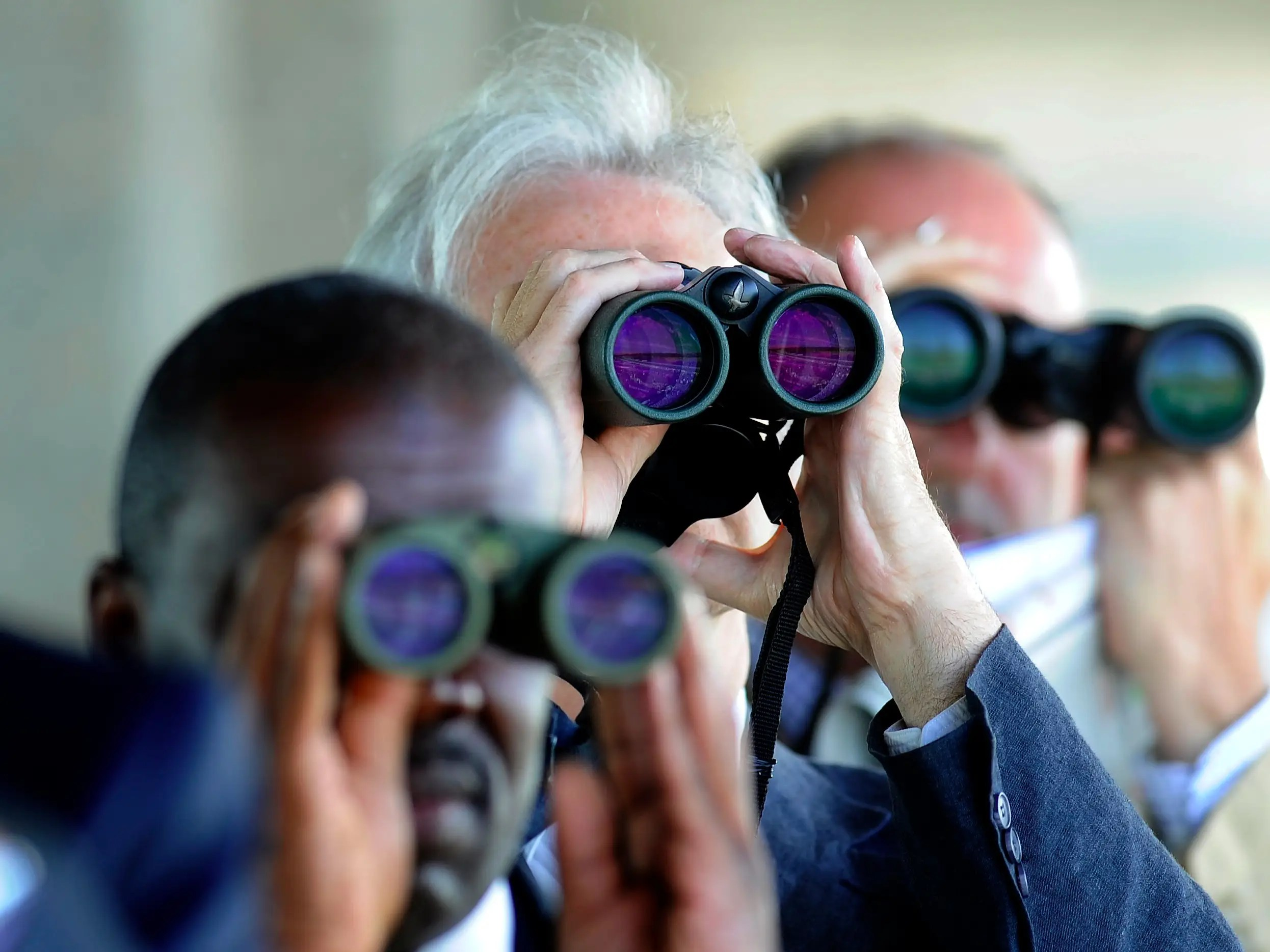 binoculars races men watching spying