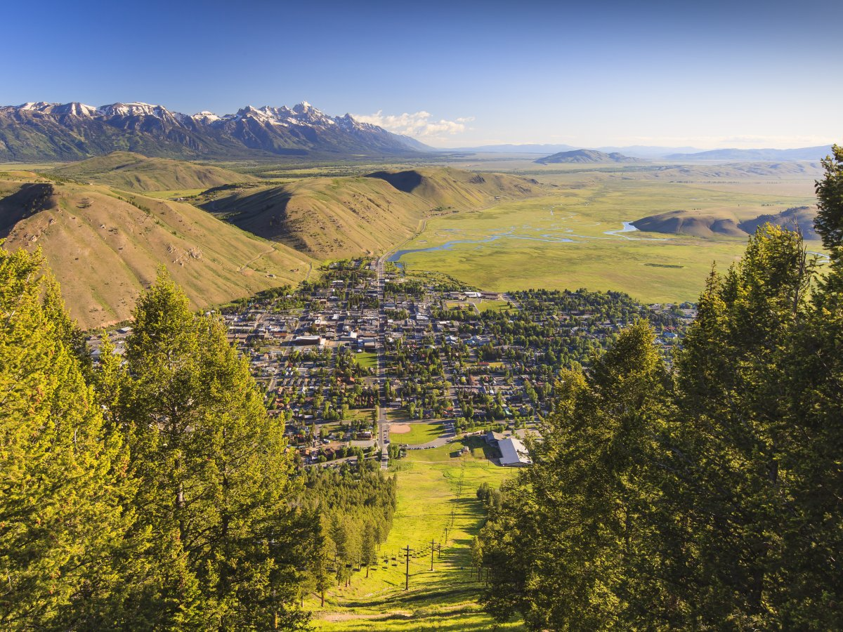 The Rocky Mountain town of Jackson, Wyoming, is home to ski slopes that get over 500 inches of fresh snow each year. In the summer, travelers can take advantage of fantastic camping grounds, live-music festivals, and top-notch restaurants.