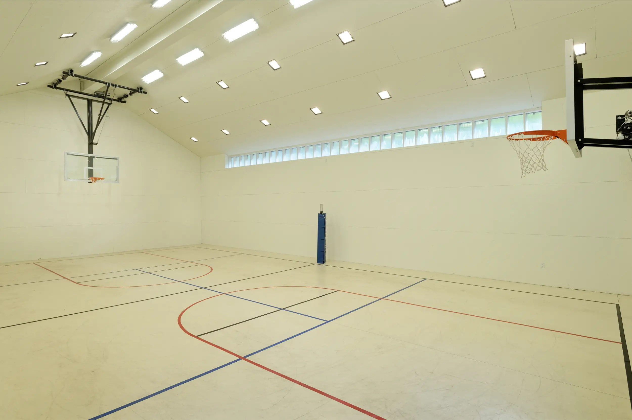 The basketball court is an unusual touch for a log cabin.