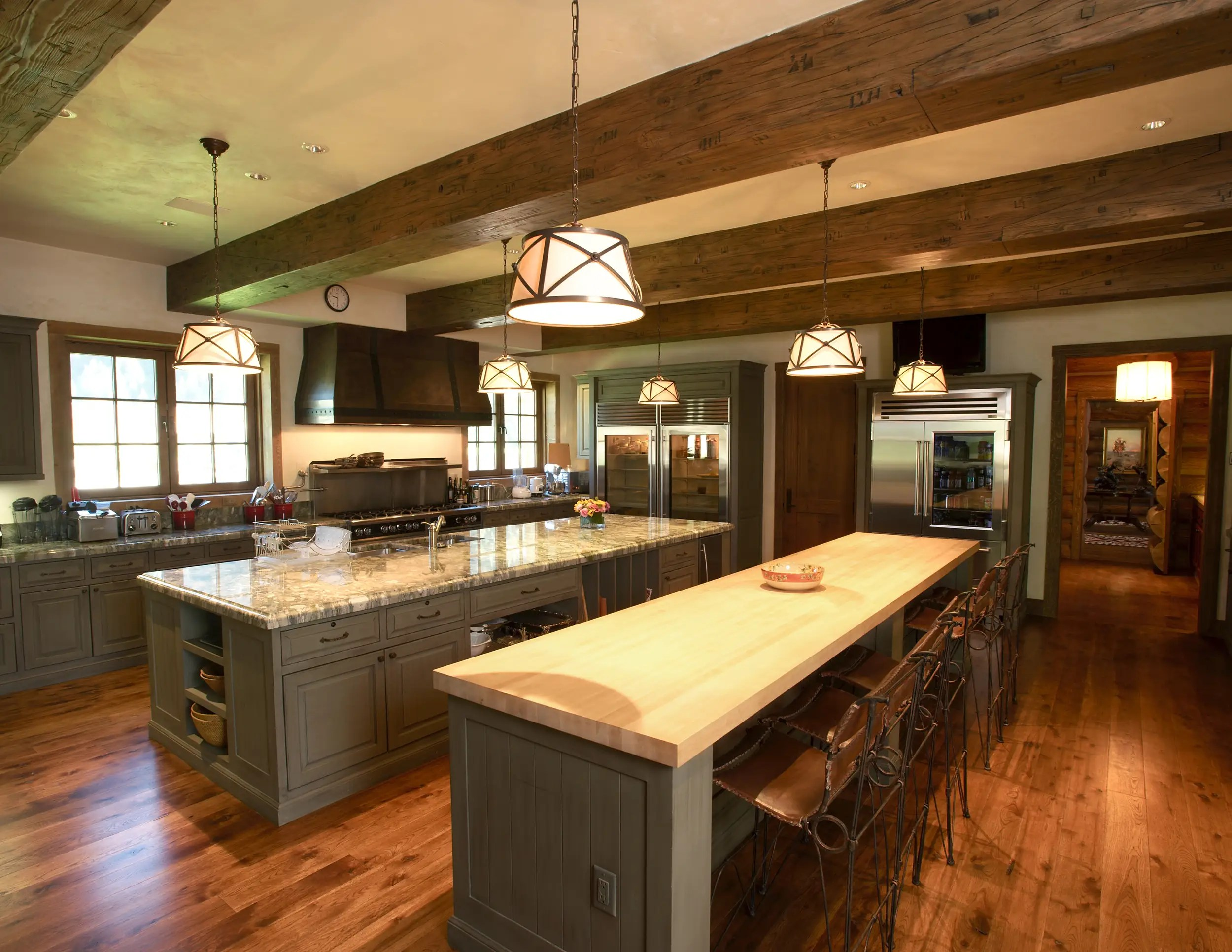 Kitchens are equipped to deal with a high volume of guests, and a temperature- and humidity-controlled wine cellar is prepared for a sizable collection.