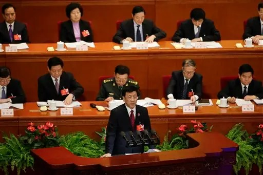 China's Supreme People's Procuratorate top prosecutor Cao Jianmin delivers a work report during a plenary session of the National People's Congress at the Great Hall of the People in Beijing, Sunday, March 13, 2016. Cao said Sunday that battling