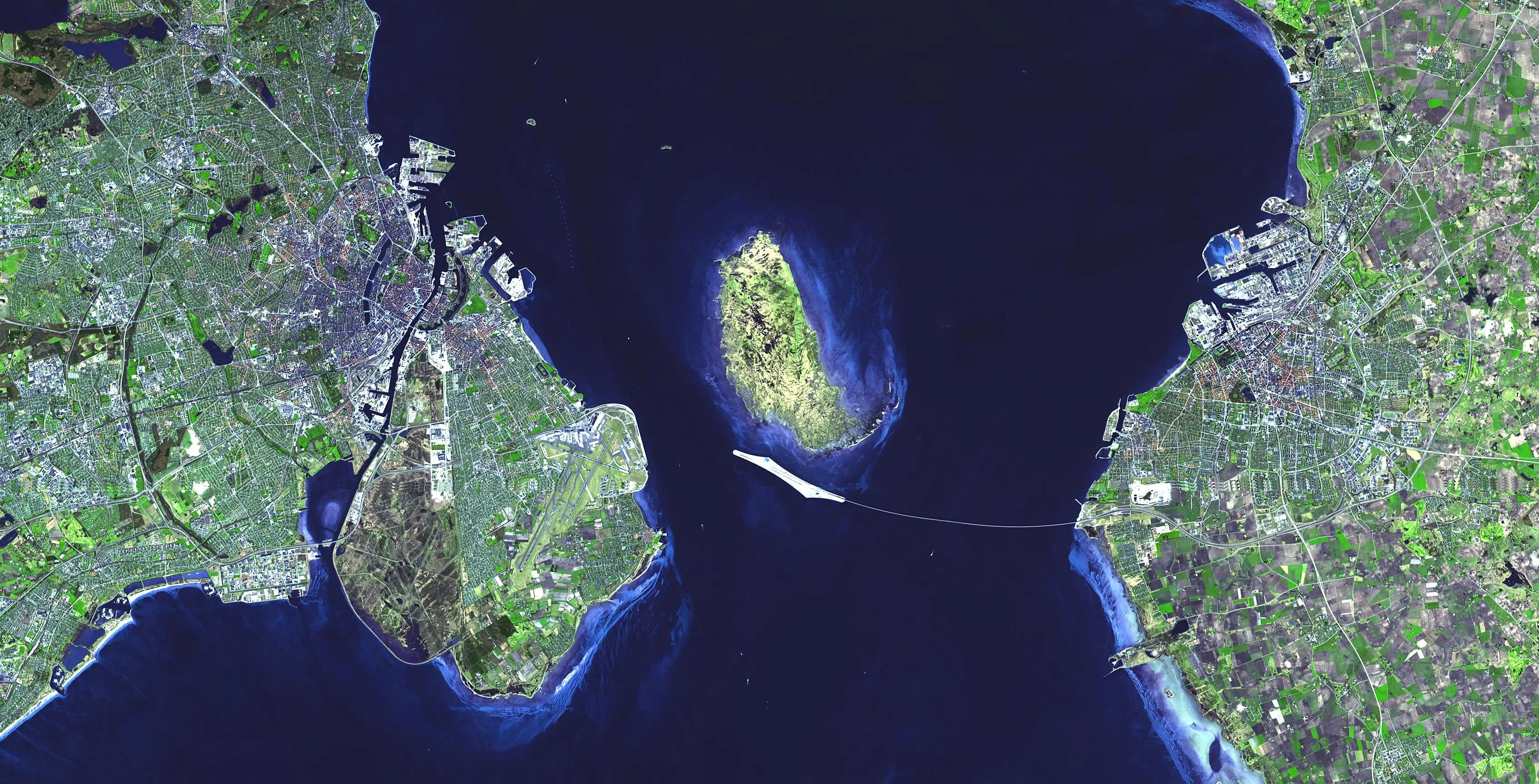 The 10-mile Oresund Bridge connects Sweden and Denmark. You can see the artificial island the countries constructed in the middle to make the trip.