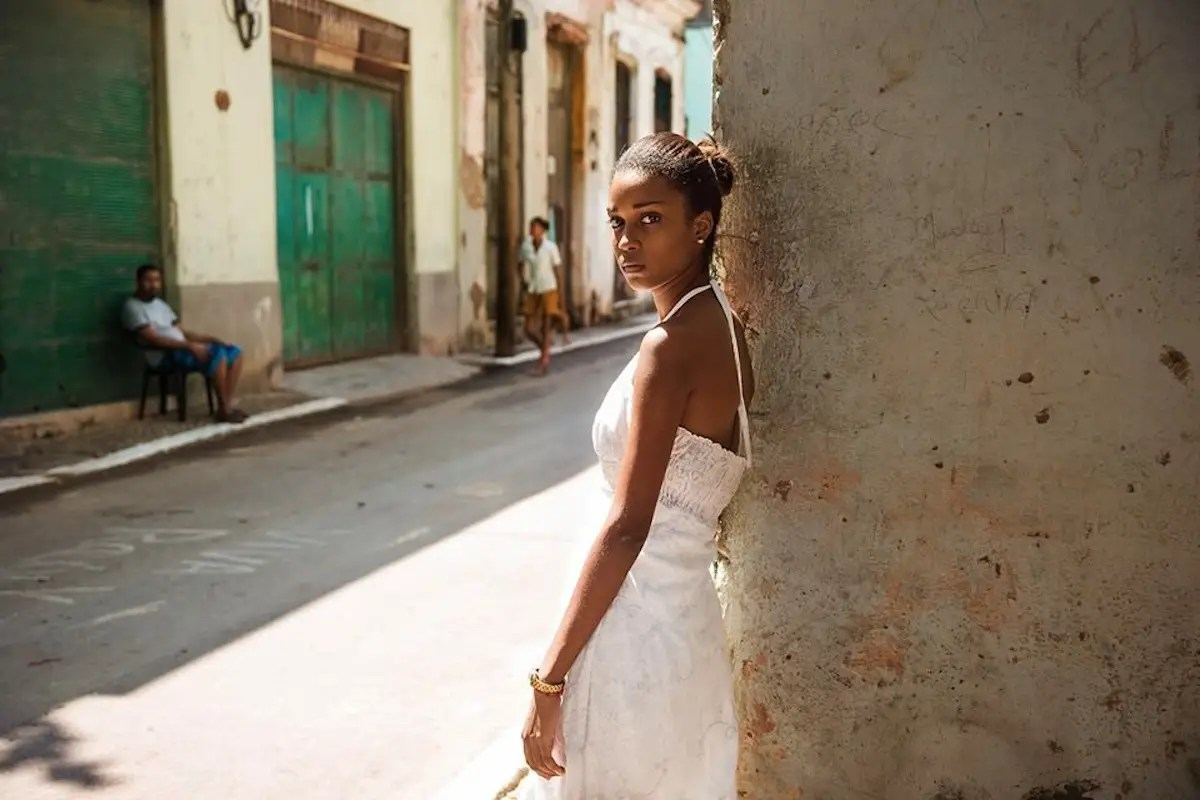 A woman poses on the streets of Havana, Cuba.