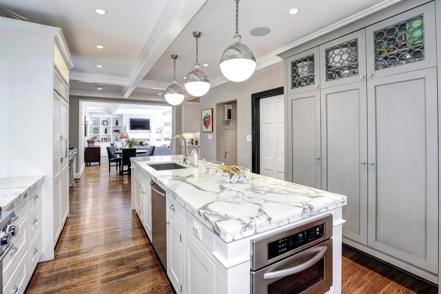 The kitchen is bright and updated, with marble countertops and luxury appliances.