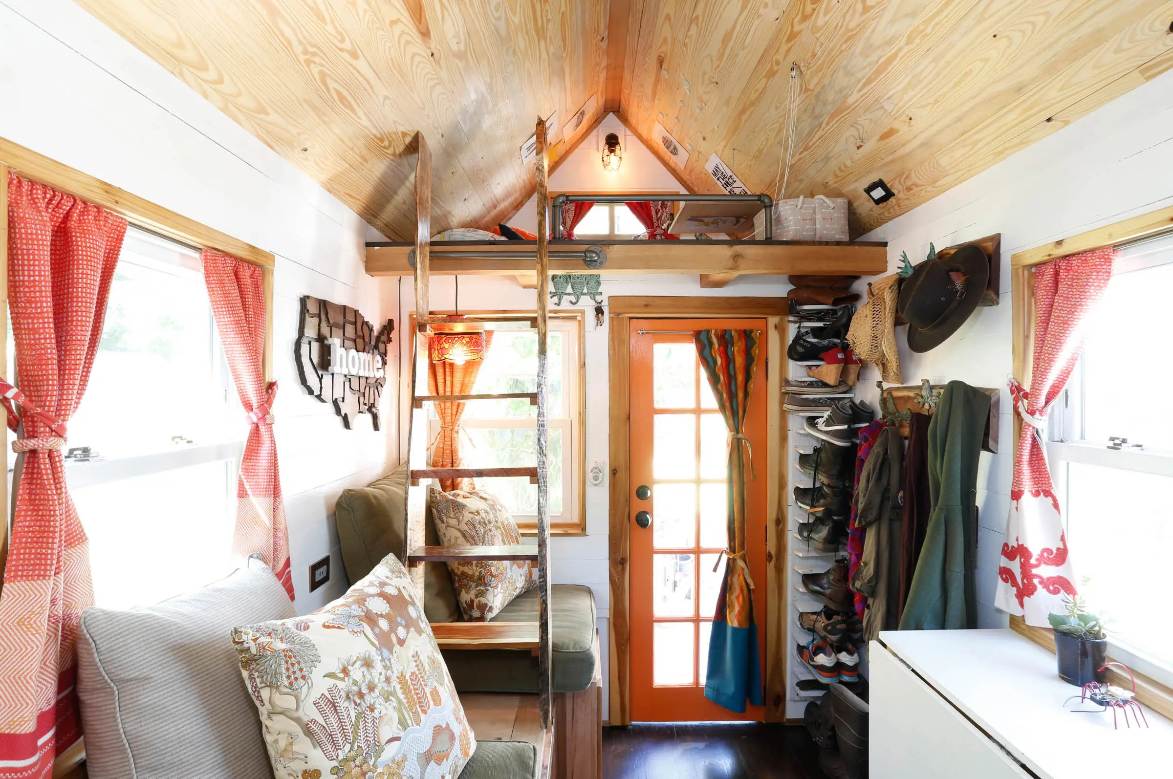 At 130 square feet, the house has a rustic cabin meets Pottery Barn catalog feel. It cost under $20,000 to build.