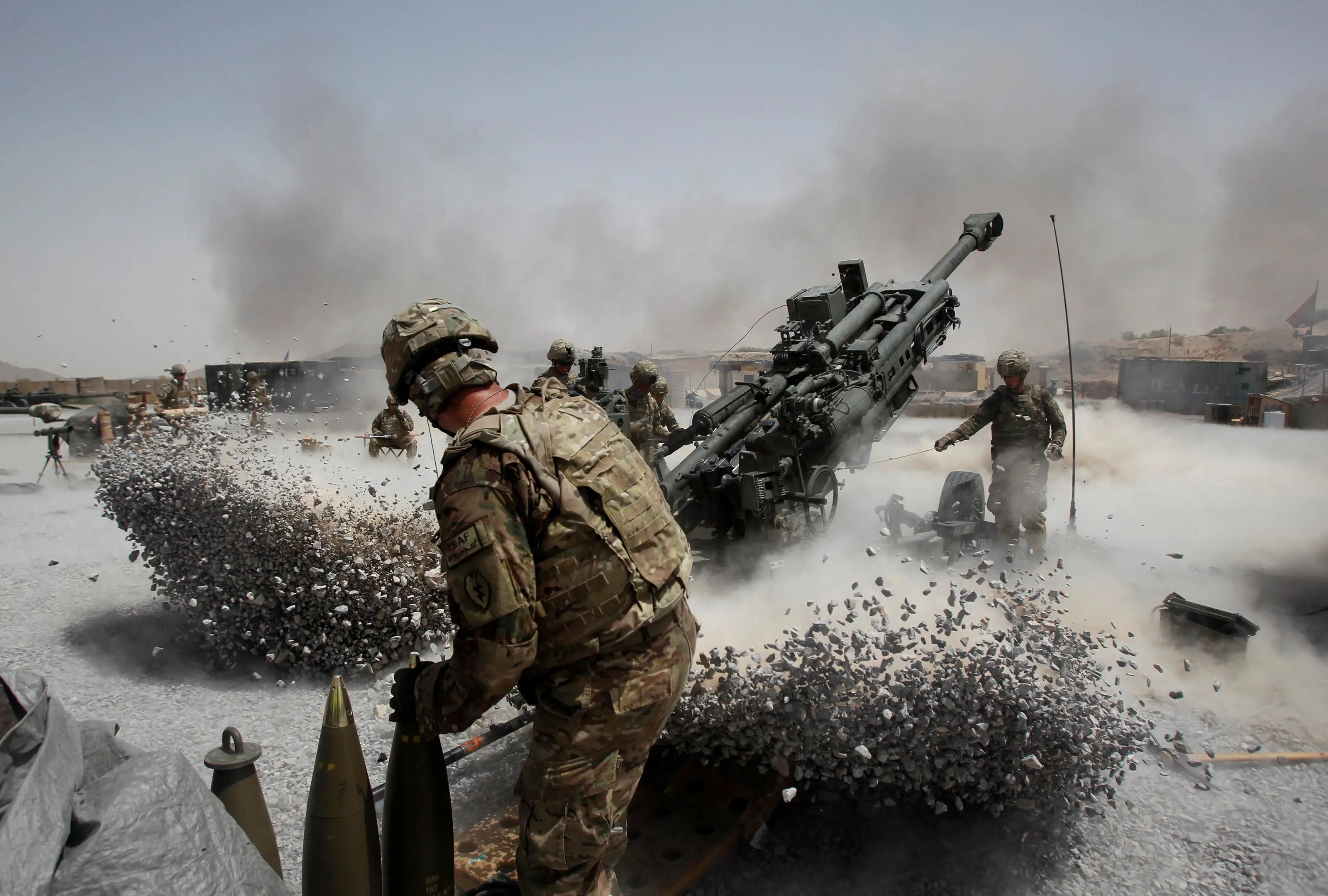 US Army soldiers from the 2nd Platoon, B battery 2-8 field artillery, fire a howitzer artillery piece at Seprwan Ghar forward fire base in Panjwai district, Kandahar province, southern Afghanistan, June 12, 2011.