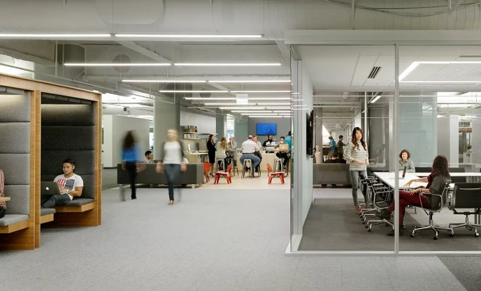 """Square's San Francisco office was designed to function like a city. Co-workers convene around a """"town square"""" coffee bar and travel down a main """"avenue"""" as opposed to a hallway."""