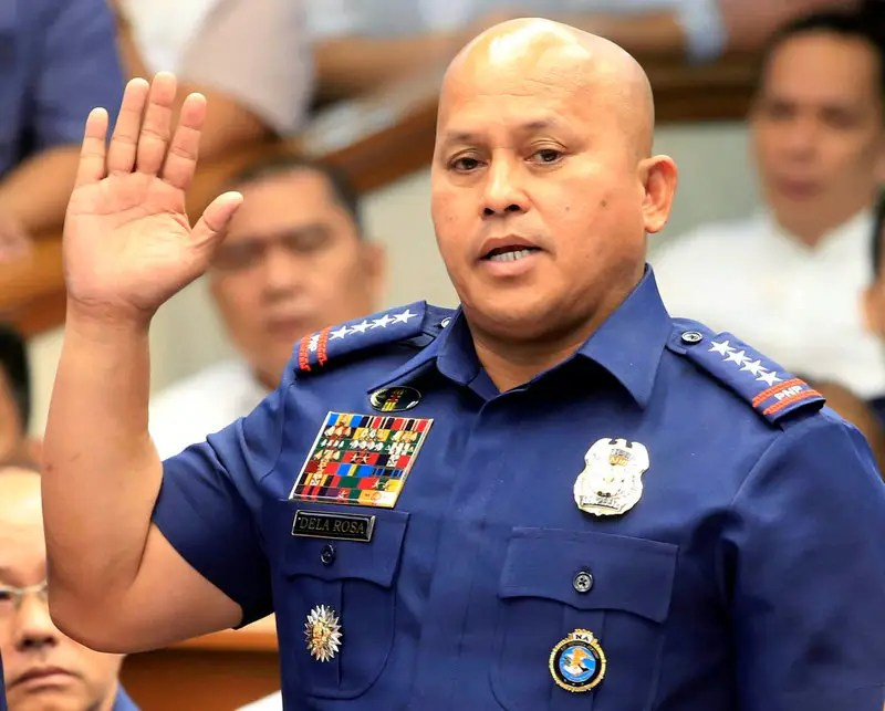 Philippine National Police (PNP) Director General Ronald Dela Rosa takes the oath during the start of a hearing investigating drug-related killings at the Senate headquarters in Pasay city, metro Manila, Philippines August 22, 2016. REUTERS/Romeo Ranoco