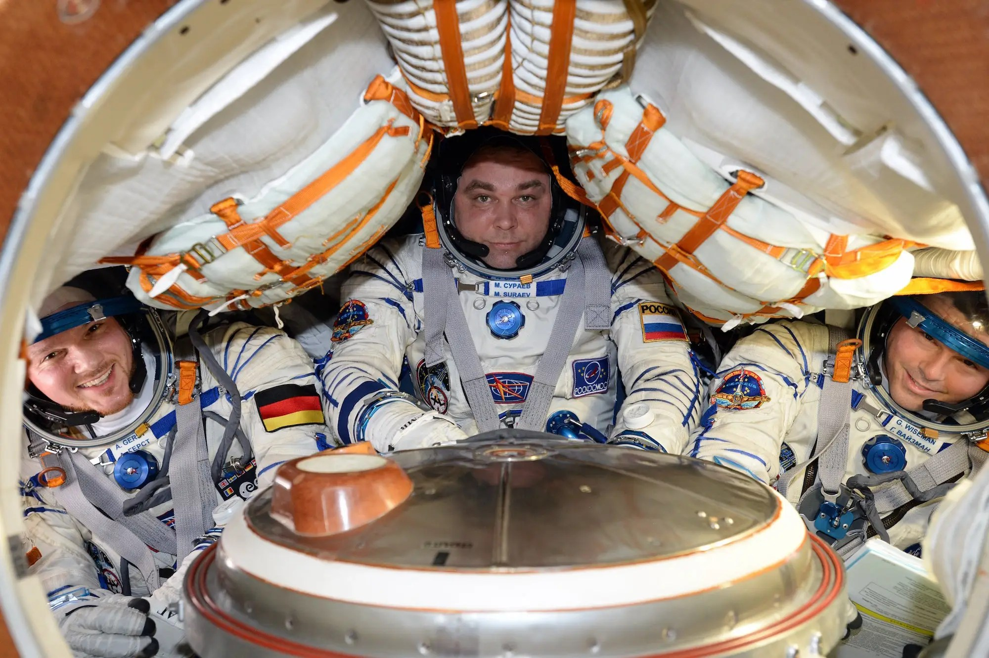 Astronauts And A Cosmonaut Buckled Into Cramped Soyuz Descent Module Make For Very Tight Fit ESA NASA