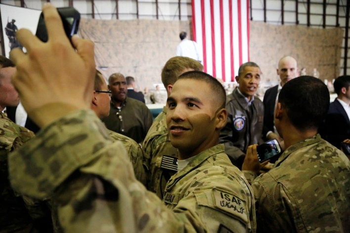 "A US service member takes a ""selfie"" as President Barack Obama shakes hands with troops after delivering remarks at Bagram Air Base in Kabul, May 25, 2014."